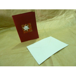Tarjeta de navidad en papel artesanal.